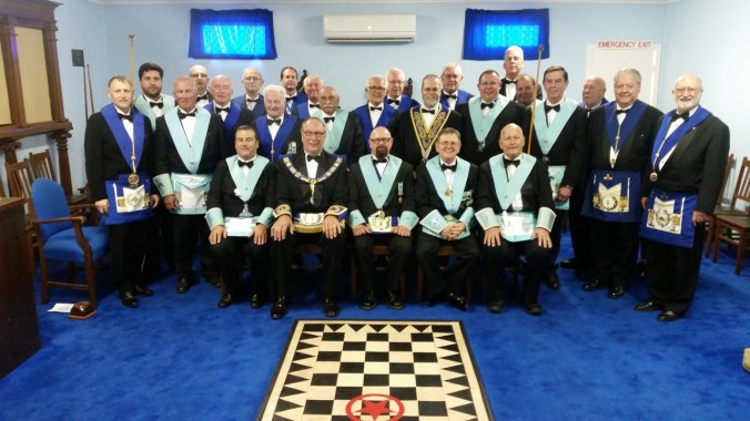 MW Bro Lewis Sheppard after his Installation with Team Members, Visitors and Lodge Members
