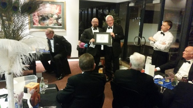 VW Bro Coomber receiving his award from MW Bro Sheppard